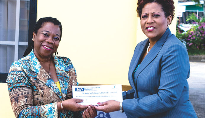 Photo (L-R): Patricia Martin-Ward (Manager of the Home) receives their cheque from Joycelyn Francois (CEO of the ECA)