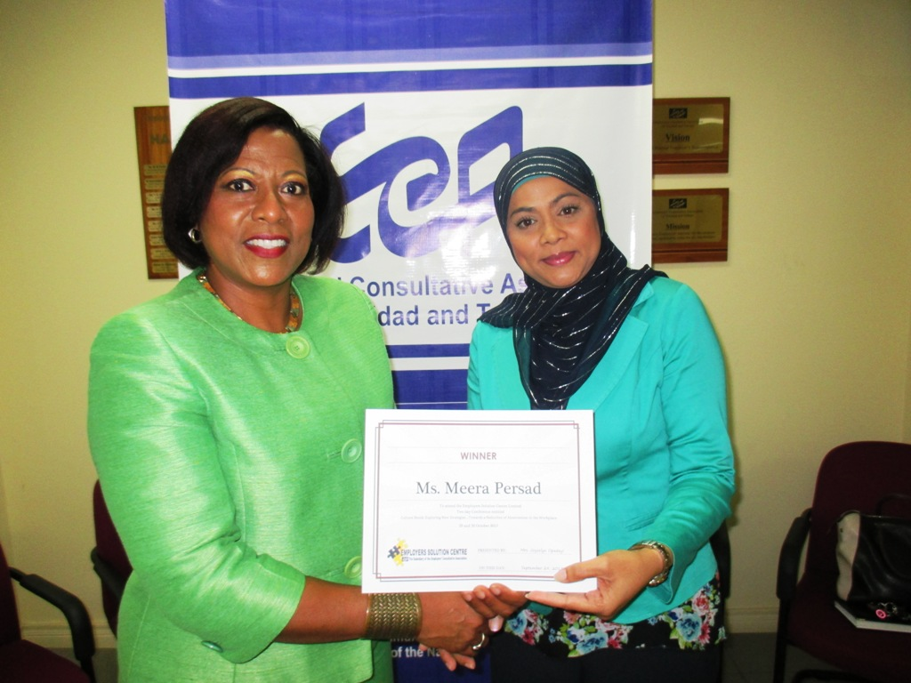L-R: ECA's CEO with Survey Winner, Meera Persad-Mohammed of R&C Enterprises Ltd.